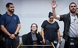 Lara Alqasem, sitting, at Tel Aviv District court on October 11, 2018. (Miriam Alster/Flash90)