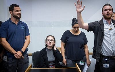 Lara Alqasem, sitting, at Tel Aviv District court on October 11, 2018. (Miriam Alster/Flash90)