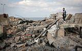 Palestinians walk on debris following an Israeli air strike around the southern Gaza Strip city of Rafah on October 17, 2018. (Abed Rahim Khatib/ Flash90)
