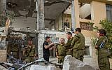 Maj. Gen. Herzi Halevi (C), the head of the IDF's Southern Command, visits a home in Beersheba that was destroyed by a rocket fired from the Gaza Strip on October 17, 2018. (Flash90)