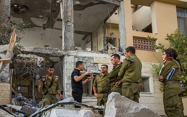 Illustrative: Maj. Gen. Herzi Halevi (C), the head of the IDF's Southern Command, visits a home in Beersheba that was destroyed by a rocket fired from the Gaza Strip on October 17, 2018. (Flash90)
