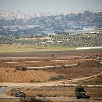 Israeli army jeeps patrol on the border with the Gaza Strip on October 17, 2018. (Yonatan Sindel/Flash90)
