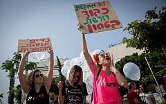 People join together as they attend a rally protesting violence against women, in Tel Aviv on October 18, 2018 (Miriam Alster/Flash90)