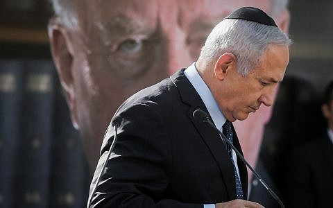 Prime Minister Benjamin Netanyahu speaks during a memorial service marking 23 years since the assassination of late Israeli Prime Minister Yitzhak Rabin, held at Mount Herzl cemetery in Jerusalem on October 21, 2018. (Marc Israel Sellem/POOL)