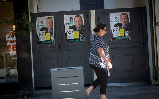 Campaign posters showing current mayor of Tel Aviv Ron Huldai, on the streets of Tel Aviv, prior to the upcoming municipality elections, on October 28, 2018. (Miriam Alster/FLASH90)