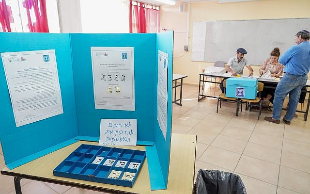 A man arrives to casts his ballot at a voting station on the morning of the municipal elections, on October 30, 2018, in Kedumim. (Hillel Maeir/Flash90)