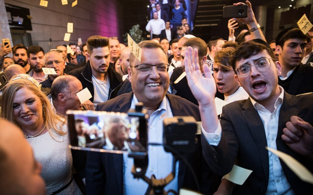 Supporters celebrate as Jerusalem mayoral candidate Moshe Lion arrives at his campaign headquarters , on October 30, 2018. (Hadas Parush/Flash90)