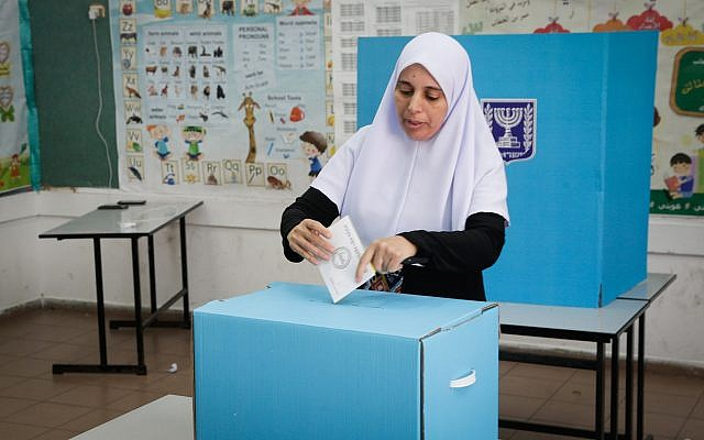 An Arab Israeli woman casts her ballot at a voting station during municipal elections, in Kafr Qasim, on October 30, 2018. Roy Alima/Flash90)