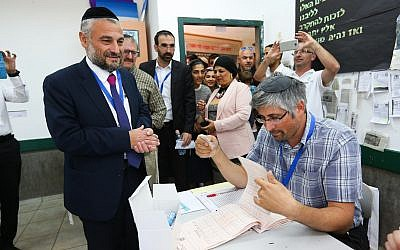 Beit Shemesh mayoral candidate Moshe Abutbul, the incumbent, casts his ballot at a voting station during the municipal elections, on October 30, 2018, in Beit Shemesh. (Yaakov Lederman/Flash90)