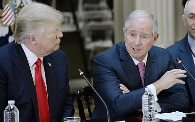 Blackstone CEO Stephen Schwarzman (R) speaks as US President Donald Trump looks on during a strategic and policy discussion with business executives at the State Department Library in the Eisenhower Executive Office Building in Washington, DC, April 11, 2017. (Olivier Douliery/Pool/Getty Images)