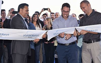 Oren Betzaleli, Country Manager - HARMAN Israel, right; Yuval Weisglass, Vice President Automotive Cybersecurity - HARMAN, center. and  HARMAN President and CEO, Dinesh C. Paliwal at the opening if the firm's new headquarters in Hod Hasharon (Oren Tesler)
