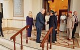 Prime Minister Benjamin Netanyahu (SL), acompanied by his wife Sara, is greeted by Sultan Qaboos bin Said in Oman on October 26, 2018 (Courtesy)