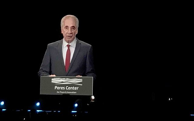 A hologram image of late Shimon Peres delivers a speech at the Prime Ministers Innovation Summit; October 25, 2018 (Shoshanna Solomon/Times of Israel)