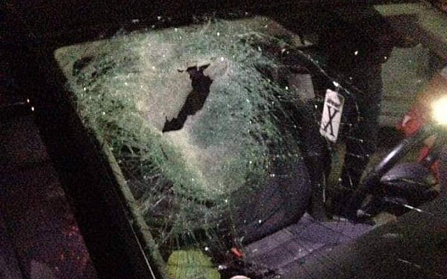 A car belonging to a Palestinian couple is seen after it was involved in a deadly crash reportedly due to stone-throwing by Israeli settlers at the Tapuah Junction in the northern West Bank on October 12, 2018. (Zachariah Sadeh/Rabbis for Human Rights)