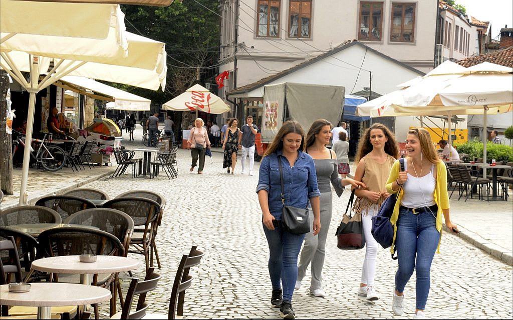 Teenage girls stroll along the cobblestone streets of downtown Prizren, the second-largest city in Kosovo. (Larry Luxner/ Times of Israel)