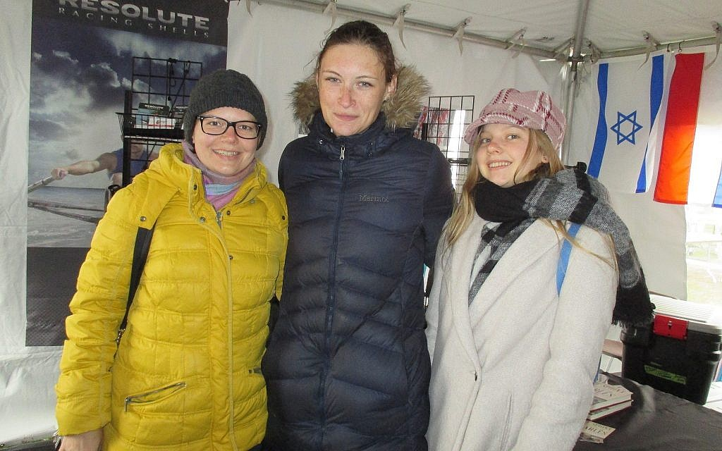 Michal Spalter (center) bundled up in a warm jacket after her race, was greeted by Anna Rosinska, a Polish cousin who is a visiting scholar at the University of Massachusetts at Lowell. Spalter's parents, who live in Tel Aviv, were originally from Poland, the home of her coach. (Penny Schwartz/ Times of Israel)