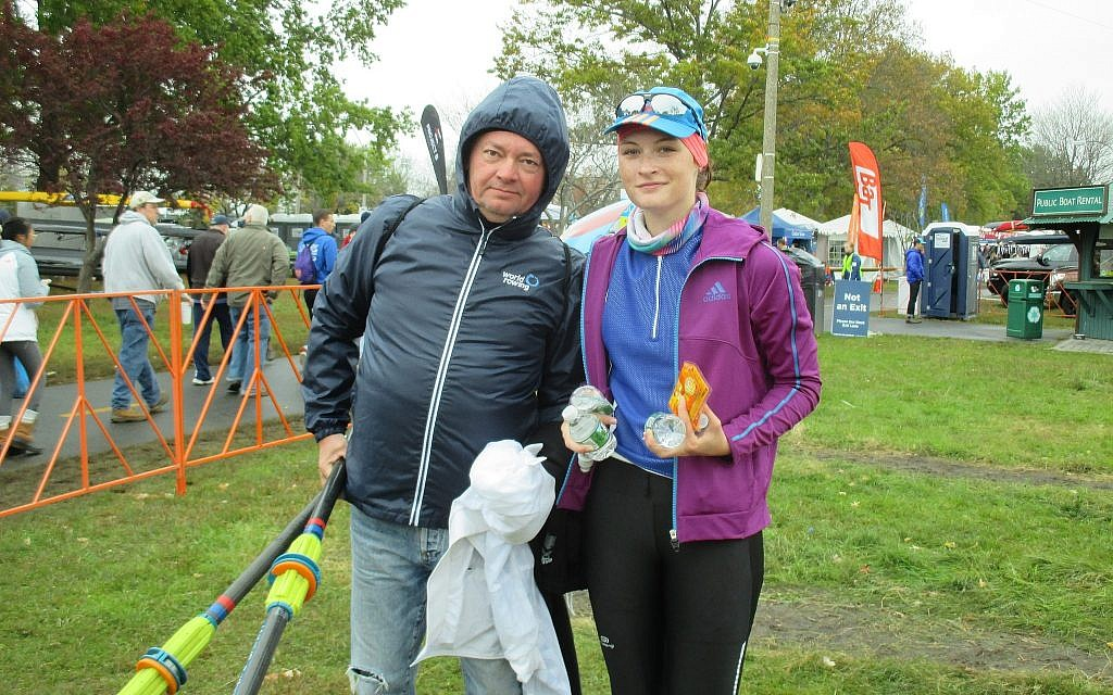 Michal Spalter, with coach Robert Nuckowski, minutes after she stepped out of her racing shell, on Sunday, October 21, at the Head  of the Charles Regatta. (Penny Schwartz/ Times of Israel)