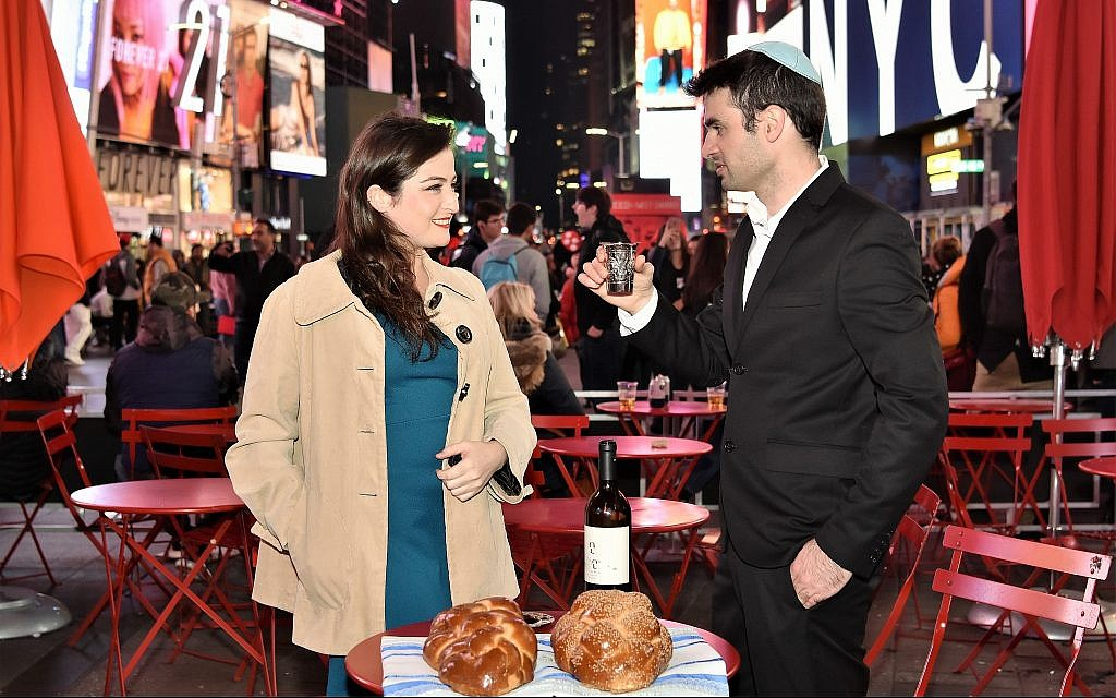 Adi Greenberger, left, and Nadav Freeman at a Shabbat Project event in New York's Times Square last year. (Ido Simantov/Courtesy)