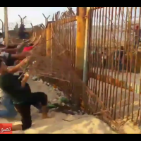 Palestinian rioters tear down a section of fencing around the northern Gaza border on October 8, 2018. (Screen capture: Quds News)