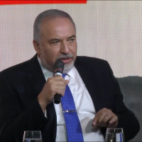 Defense Minister Avigdor Liberman speaks on stage, at the Maariv conference in Jerusalem, October 15, 2018. (Screen capture)