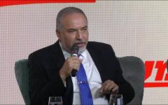 Defense Minister Avigdor Liberman speaks on stage, at the Maariv conference in Jerusalem, October 15, 2018. (Screen capture)