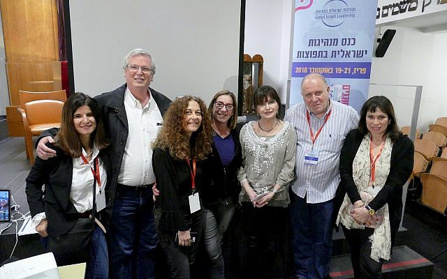 Global Israeli Leadership (GIL) board members pose for photo with visiting author from Israel, Mira Magen, (3rd from right) who spoke at the conference Sunday, October 21, 2018. (Doug Dalgleish)