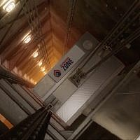 Salamandra Zone's B-Air unit fits on top of elevators and purifies air during emergencies. (YouTube screenshot)
