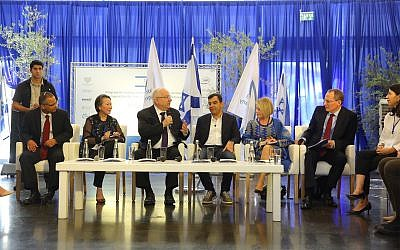 President Rivlin (seated, third left) at the inauguration of the program in Jerusalem to boost Arab and, Haredim in the Israeli tech sector. (Yanai-Rubaja)