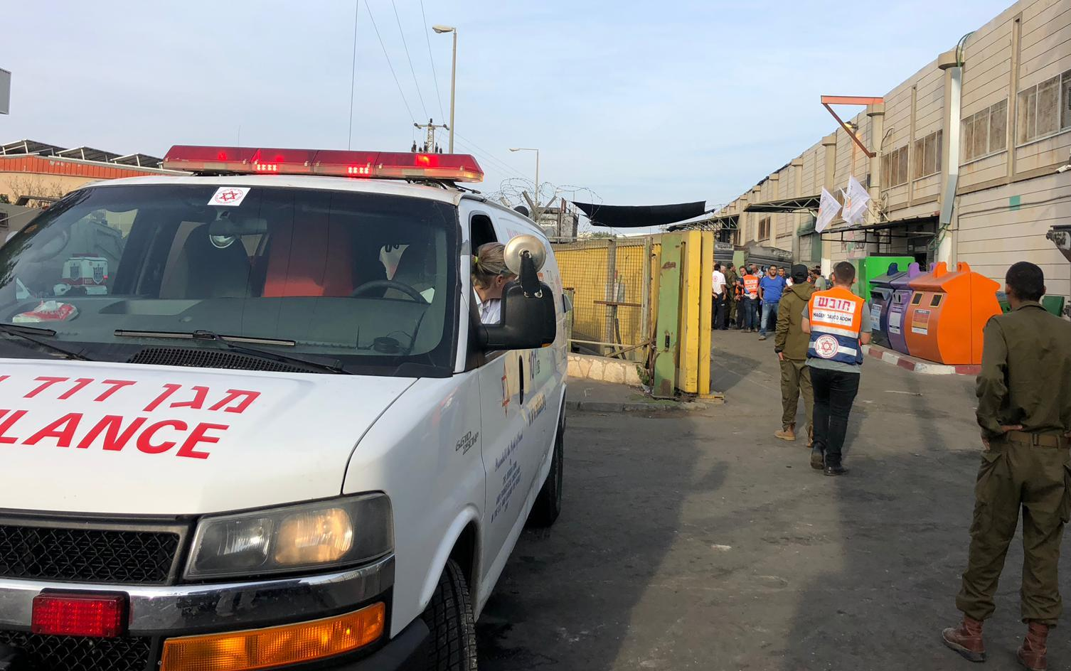 Medics and security forces arrive at the scene of a shooting attack in the Barkan Industrial Park in the northern West Bank