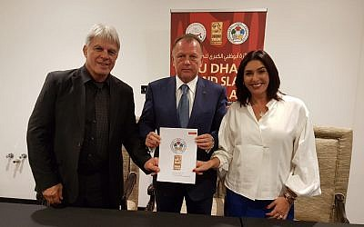 (L-R) Culture Minister Miri Regev, international Judo Federation president Marius Vizel and Israel Judo Association chairman Moshe Ponte sign an agreement for Israel to host a Grand Prix in 2018, October 28, 2018. (Guy Inbar)