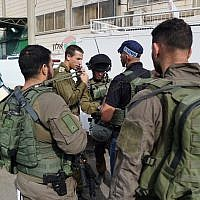 Israeli security forces at the scene of a fatal shooting attack in Barkan Industrial Park in the northern West Bank on October 7, 2018. (Israel Defense Forces)