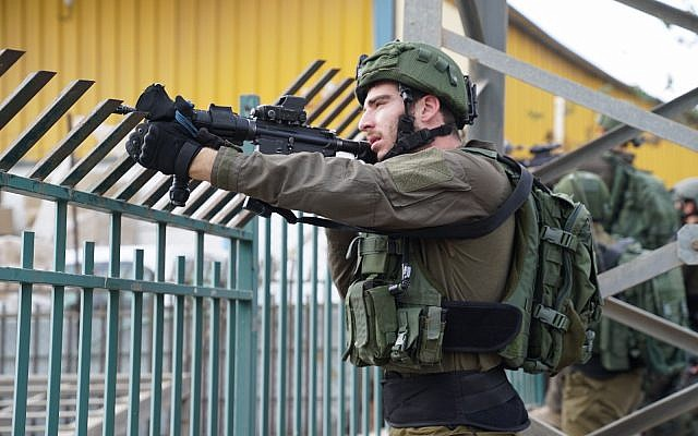 Israeli security forces search the northern West Bank after a fatal shooting attack in Barkan Industrial Park in the northern West Bank