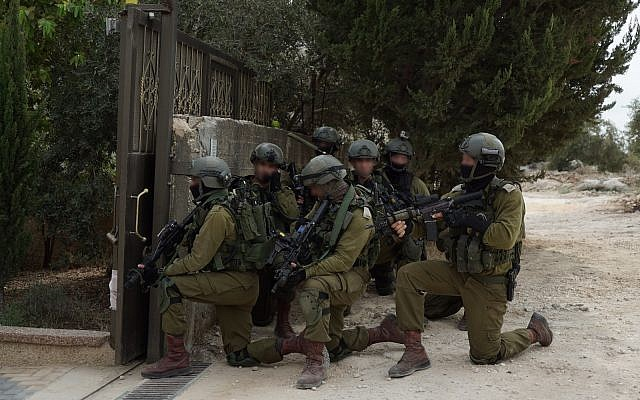 Israeli troops searching for suspected Barkan shooter Ashraf Na'alowa in the northern West Bank village of Shuweika on October 7, 2018. (Israel Defense Forces)
