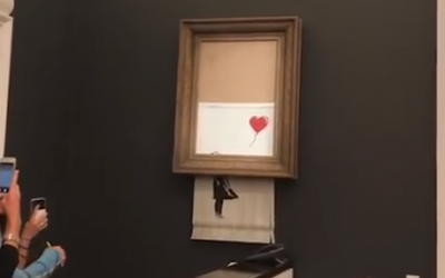 Banky artwork self destructs at London auction house, October 5, 2018 (YouTube screenshot)