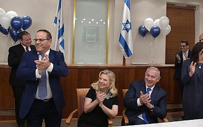 Prime Minister Benjamin Netanyahu at a birthday celebration at his office in Jerusalem on October 24, 2018. (Amos Ben Gershon/GPO)