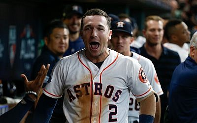 American Jewish baseball player Alex Bregman reacts in the dugout after hitting a home run in the second game of the American League Division Series against the Cleveland Indians at Minute Maid Park in Houston, October 6, 2018. (Bob Levey/Getty Images/via JTA)