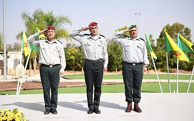 Brig. Gen. Yehuda Fuchs, right, Maj. Gen. Herzi Halevi, the head of the IDF Southern Command, center, and Brig. Gen. Eliezer Toledano at a ceremony to install the latter as the new head of the IDF's Gaza Division, October 24, 2018. (IDF Spokesperson)