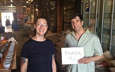 A.J. Jacobs, right, at the roastery where they roast his local coffee: the Joe Coffee Company in Brooklyn, New York. He is pictured with the plant's roaster and taster. (Courtesy of Jacobs/via JTA)