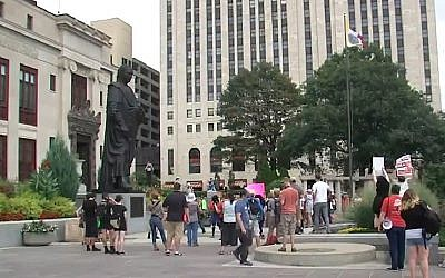 Demonstrators protest against a statue of Christopher Columbus, in Columbus, Ohio, on August 22, 2017. (Screen capture; YouTube)