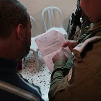 Illustrative. Israeli forces issue a demolition order for the West Bank home of Ashraf Na'alowa, the suspected terrorist who shot and killed two Israelis at the Barkan Industrial Park, October 15, 2018 (IDF Spokesperson's Unit)