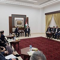 Members of the liberal Mideast policy group J Street meet with Palestinian Authority President Mahmoud Abbas at his headquarters in Ramallah, October 17, 2018. (Courtesy)