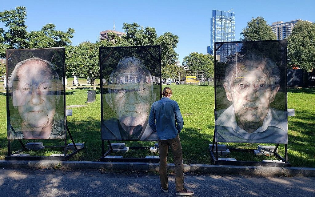Portraits of Holocaust survivors on Boston Common for the 'Lest We Forget' remembrance installation, Boston, Massachusetts, October 16, 2018 (Matt Lebovic/The Times of Israel)