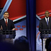 Florida Republican gubernatorial candidate Ron DeSantis, left, speaks about his Democratic opponent Andrew Gillum during a CNN debate, Sunday, Oct. 21, 2018, in Tampa, Florida (Photo by Chris O'Meara-Pool/Getty Images via JTA)