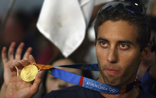 Israel's only Olympic gold medalist Gal Fridman celebrate as he arrives home in Ben Gurion Airport in Tel Aviv, Aug. 30, 2004. (Uriel Sinai/Getty Images via JTA)