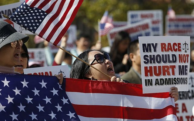 A demonstrator participates in a rally in Boston's Copley Square in support of a lawsuit against Harvard contending that the university discriminates against Asian Americans in admissions, October 14, 2018. (Jessica Rinaldi/The Boston Globe via Getty Images/via JTA)