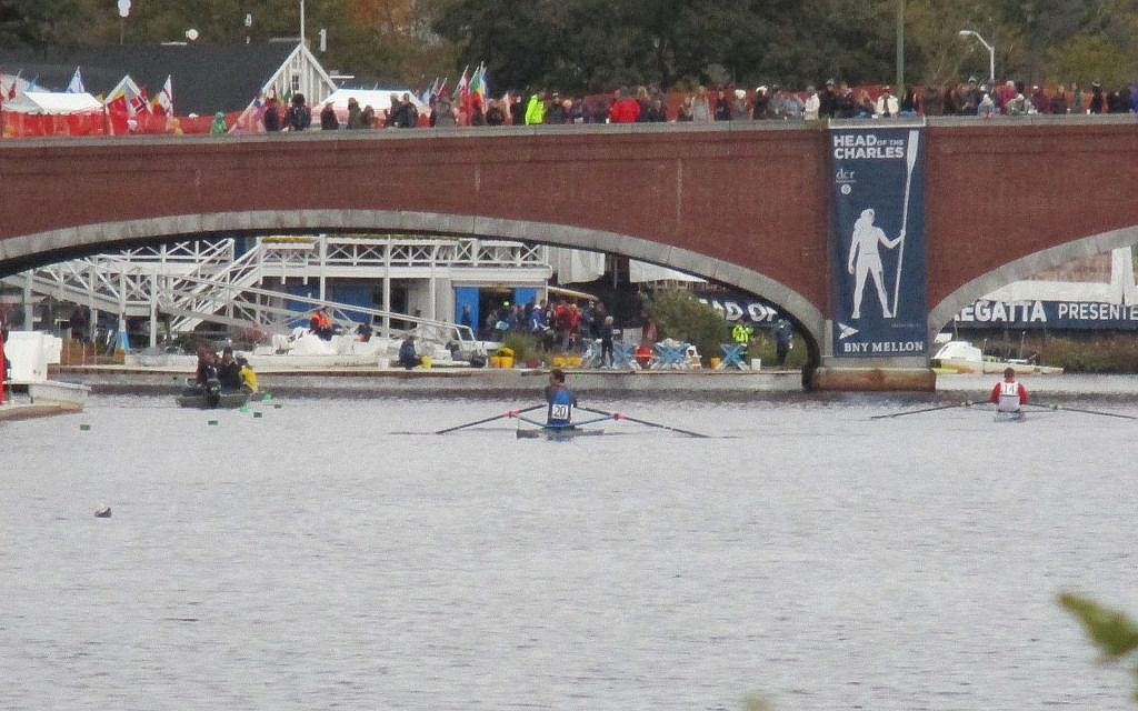 Damp and cold weather didn't keep fans from cheering racers from the Eliot Bridge in Cambridge, at the Head of the Charles Regatta, where some 300,000 spectators turned out for the two-day race. (Penny Schwartz/ Times of Israel)