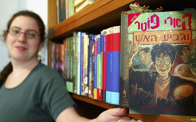 Gili Bar-Hillel with her Hebrew-language version of 'Harry Potter and the Goblet of Fire,' one of the four Harry Potter books she translated, in her Tel Aviv office, June 23, 2003. (David Silverman/Getty Images via JTA)