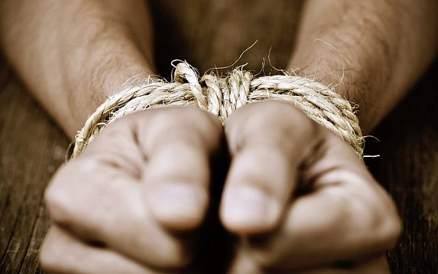 Illustrative: The hands of a young man tied with rope (nito100; iStock by Getty Images)