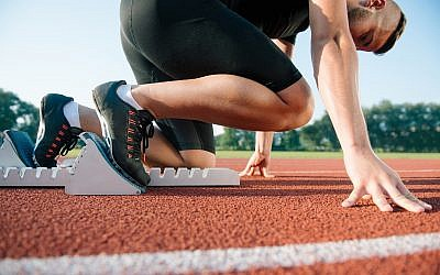 Illustrative image of a runner, preparing for a race (FS-Stock; iStock by Getty Images)