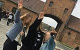 Image posted to Instagram and later deleted showing three youngsters performing a salute at Auschwitz, October 2018 (via Instagram)